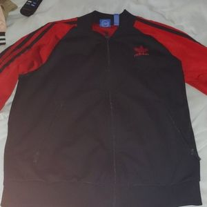 A black and red adidas zip up sweater.
